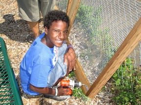 boy working on the raised bed for barnum garden
