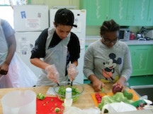 students cutting vegetables