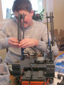 Granby 4-H youth member working on robotics
