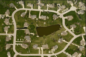 aerial image of retention pond in residential neighborhood