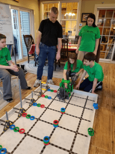 4-H members work on their vex robotics project in Granby