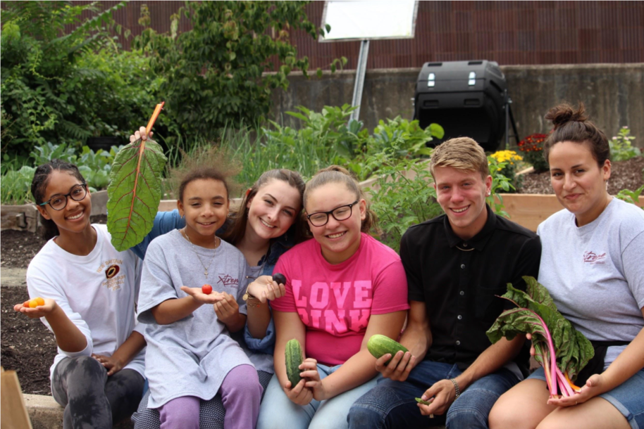 New Britain ROOTS summer program participants with vegetables they grew in the garden