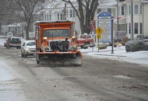 snow plow on a street in Connecticut during winter storm