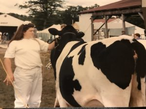 Erin Morrell as a 4-H member showing her dairy project.