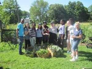 Marlene Mayes with a group of students at Auerfarm in Bloomfield