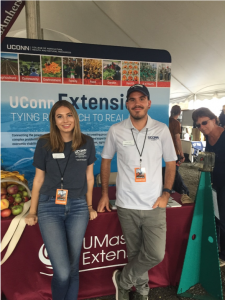 Casey and Evan at Extension booth at Farm Aid