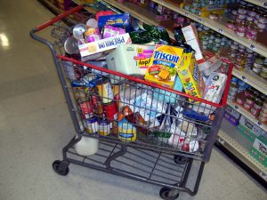 grocery store shopping cart filled with food