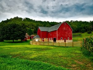 red barn with fence around it