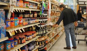 man shopping in a grocery store aisle