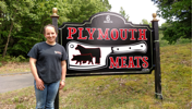 Katie Adkins in front of Plymouth Meats sign