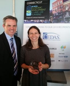 Laura Brown receiving the award with CEDAS President and CEO of the Greater New haven Chamber of Commerce, Garret Sheehan.