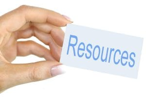 hand holding a card that says resources