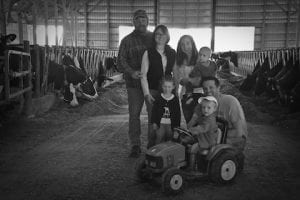Morin and Hermonot families with their cows in Woodstock, Connecticut
