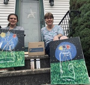 Sherry Gray & daughter holding paintings